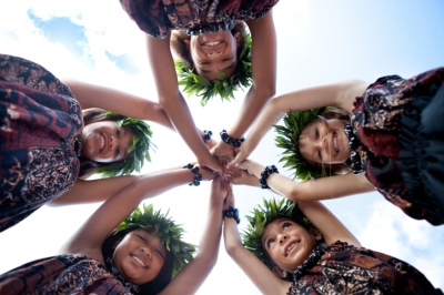 Young Hawaiian girls wearing head dresses made of leaves