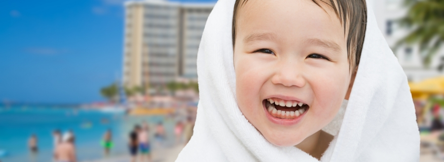 Child smiling on an Oahu Beach