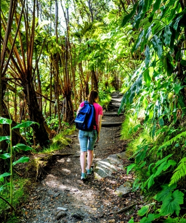 Woman hiking on a trail on Oahu