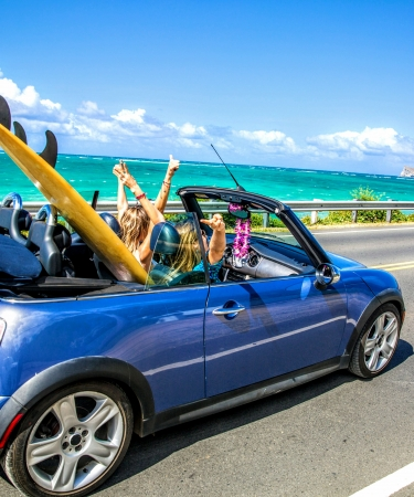 Girls in convertible driving around Oahu