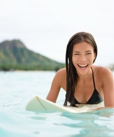 Girl on a surfboard on Waikiki Beach