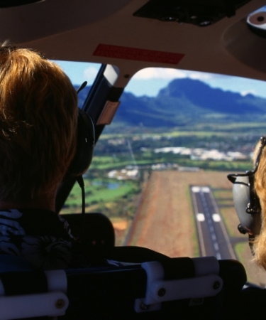 People riding in a helicopter over Oahu