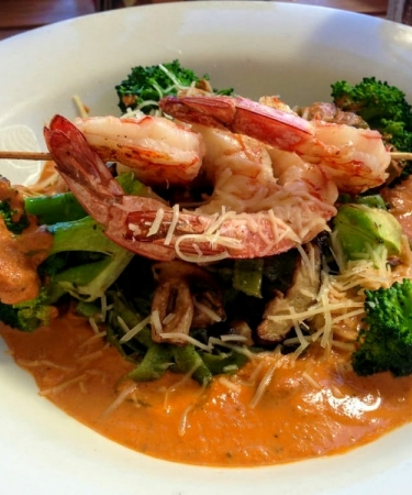 Shrimp over broccoli in sauce