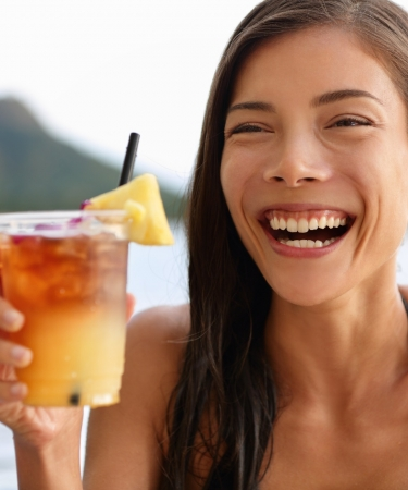 Woman with a Fruity Drink on the Beach