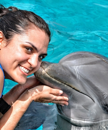 Woman with dolphin