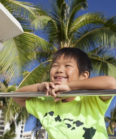 Young boy on balcony in Hawaii