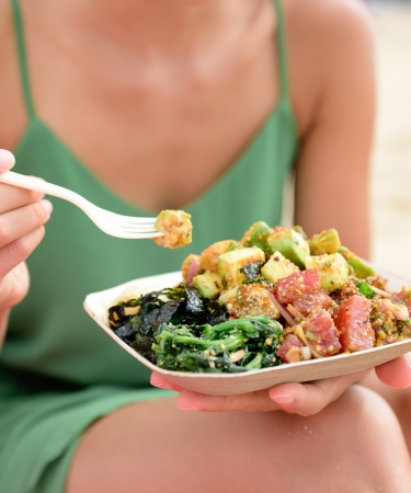 Woman Eating a Poke Bowl, Oahu Dining