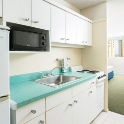 Kitchenette in guest room at Ambassador Hotel Waikiki Beach