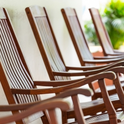 Row of rocking chairs at Ambassador Hotel Waikiki Beach