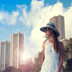Woman with a hat in downtown Honolulu