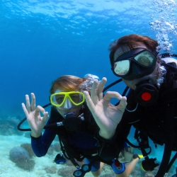 Two scuba divers off of Oahu