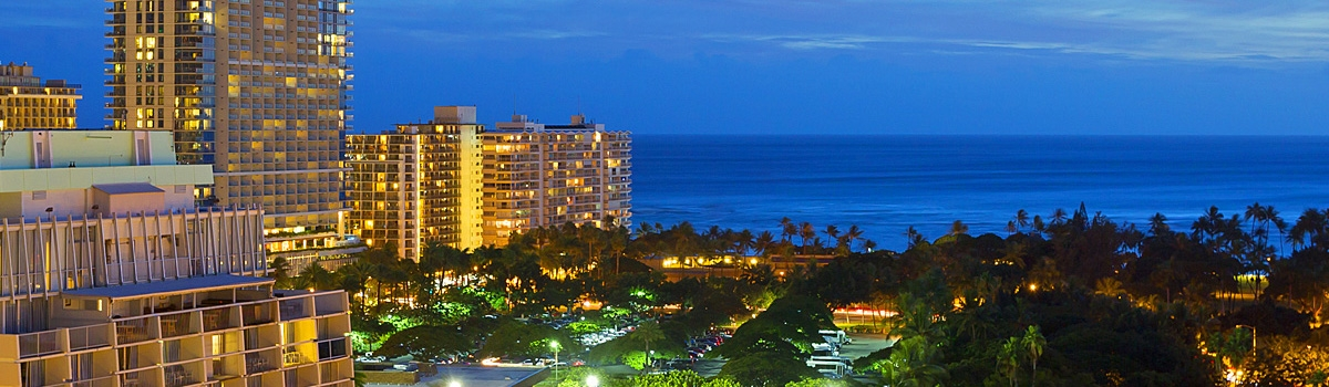 Nighttime aerial view of Ambassador Hotel Waikiki Beach