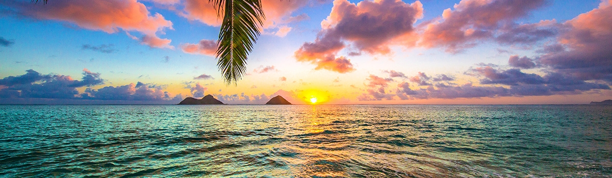 Colorful sunrise over the waters of Oahu