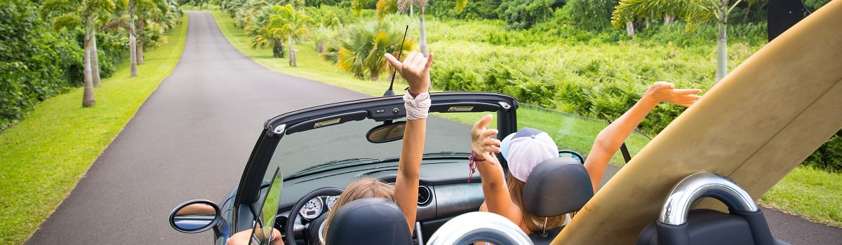 Ladies in convertible in the valley in Oahu