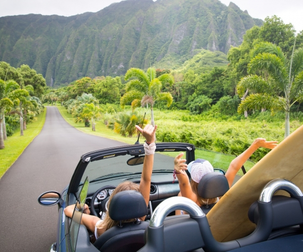 Two women in a convertible on Oahu