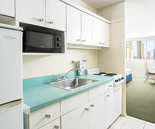 In-room kitchenette at Ambassador Hotel Waikiki Beach