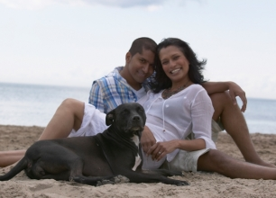 Hawaiian Couple on the beach with a dog