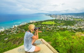 Woman Taking Pictures from a high vantage point on Oahu