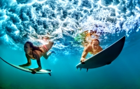 Two girls diving underwater - Oahu Activities