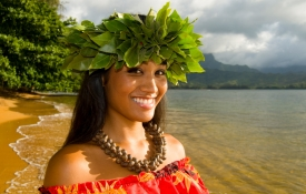 Woman on the beach in a Hawaiian head dress