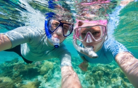 Couple Snorkeling off Oahu