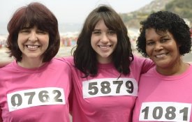 Women in Pink Shirts with Running Bibs